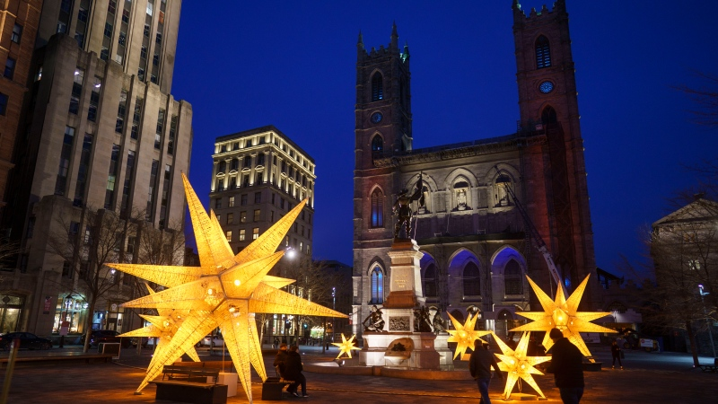 Christmas decorations are seen in front of the Notre-Dame Basilica in Montreal, Thursday, Nov. 19, 2020. Quebec Premier Francois Legault announced his government's COVID-19 plan for the Holiday Season. THE CANADIAN PRESS/Paul Chiasson