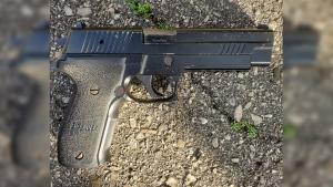 A handgun seen on the pavement. (Source: Waterloo Regional Police Service)