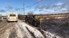 Firefighters and other emergency responders aid a woman who was trapped after her car flipped onto its side in a ditch on McVagh Road in Vars. Nov. 23, 2020. (Photo courtesy of Ottawa Fire Services)