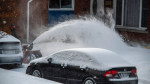 Homeowner clearing driveway of snow in Ottawa, Ont. (Photo by Ron Binette on Unsplash)