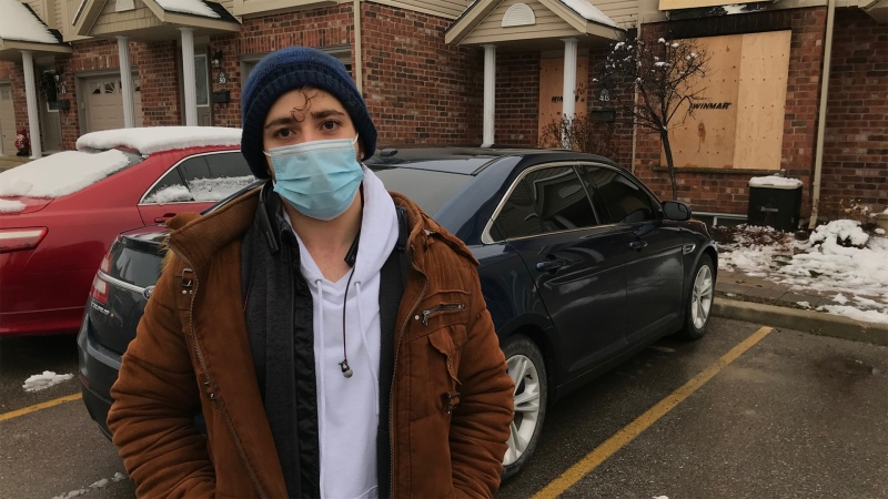 Abdullah Alhaddad is a brother and uncle to the three people critically injured in a townhouse fire on Nov. 21. He stands at the scene of the blaze in a complex on Purser Street in northeast London, Ont. on Monday, Nov. 23, 2020. (Sean Irvine / CTV News)