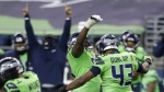 Seattle Seahawks defensive end Carlos Dunlap (43) celebrates with defensive end L.J. Collier, centre-left, after Dunlap sacked Arizona Cardinals quarterback Kyler Murray late in the second half of an NFL football game, Thursday, Nov. 19, 2020, in Seattle. The Seahawks won 28-21. (AP / Lindsey Wasson)