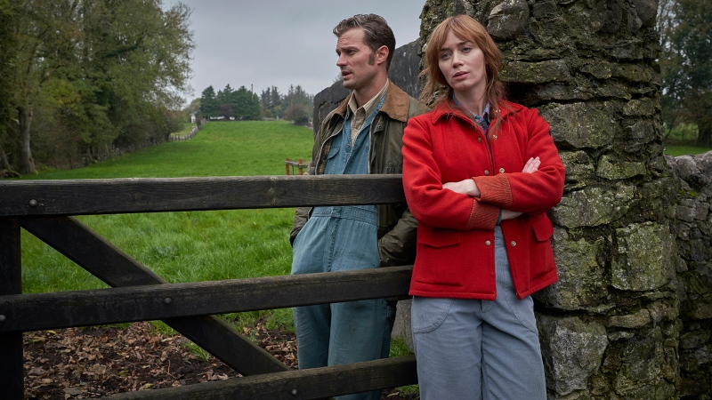 Love across the barricades: Anthony Reilly (Jamie Dornan) and Rosemary Muldoon (Emily Blunt) are seen in some couture-level farmwear. (Kerry Brown / Bleecker Street / CNN)