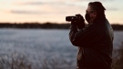Greg Scriver takes a photo of a sunset along the Ottawa River. The Orléans man rediscovered his love for photography during the COVID-19 pandemic, taking photos of sunsets daily. (Joel Haslam / CTV News Ottawa)