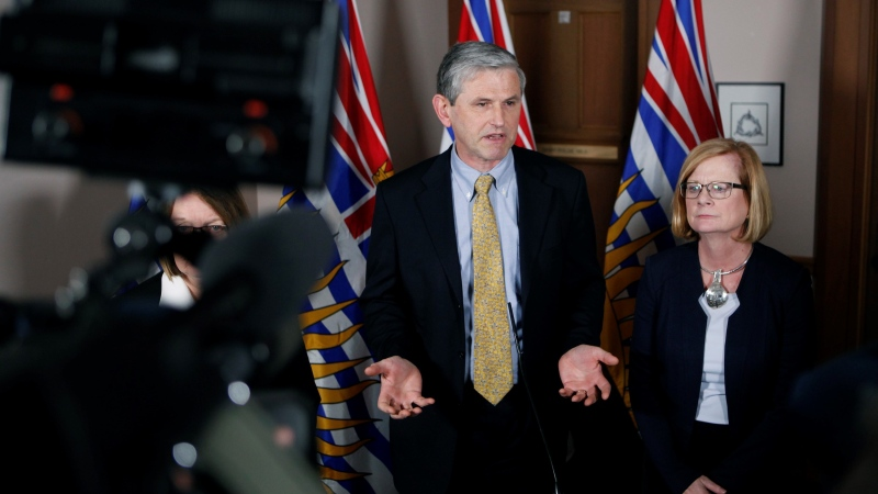 Then-Liberal leader Andrew Wilkinson stands next to MLA Tracy Redies, right, during a news conference following the budget speech from the legislative assembly at Legislature in Victoria., on Tuesday, Feb. 19, 2019. (Chad Hipolito / THE CANADIAN PRESS)