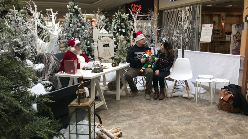 Santa Claus is pictured with the Becker family at Victoria Square Mall. (Cally Stephanow / CTV News Regina)