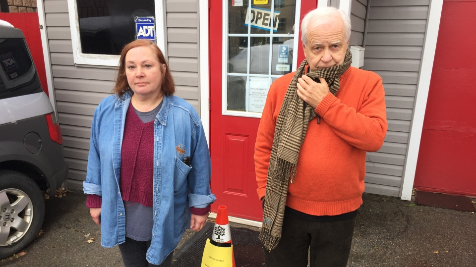 Denise and Dennis Krogman of Dennis Krogman Auto Sales speak against the location of the permanent safe consumption site in London, Ont. on Monday, Nov. 23, 2020. (Bryan Bicknell / CTV News)