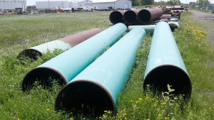 In this June 29, 2018 file photo, pipeline used to carry crude oil is shown at the Superior terminal of Enbridge Energy in Superior, Wis. (AP Photo/Jim Mone)