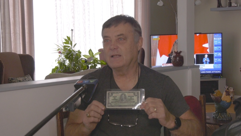Orest Lawryniw of Timmins holds up a one dollar bill from 1937 depicting King George V.  He said it's worth about eighty-five dollars. Nov.23/20 (Lydia Chubak/CTV News Northern Ontario)