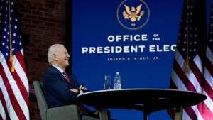 U.S. President-elect Joe Biden attends a meeting at The Queen theater Monday, Nov. 23, 2020, in Wilmington, Del. (AP Photo/Carolyn Kaster)