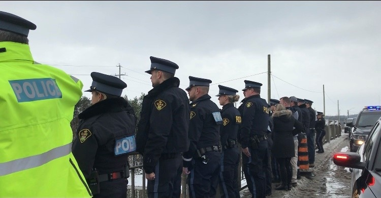 Members of the OPP and first responders give a final salute to a fellow officer killed in the line of duty. Innisfil, Ont., on Mon., Nov. 23, 2020. (Lexy Benedict/CTV News)