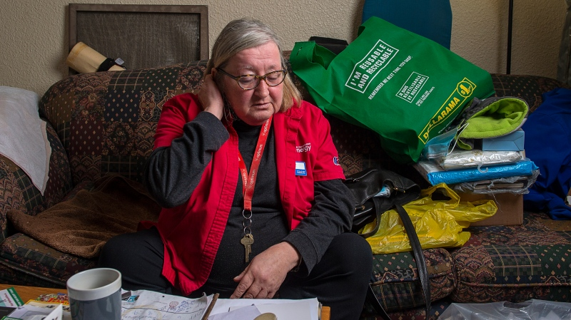 Grace Fogarty sits at home in her Halifax apartment on Monday, Nov. 23, 2020. Fogarty is facing eviction as the landlord wants to repair and renovate her apartment. Her rent will almost double if she remains in the building. (THE CANADIAN PRESS/Andrew Vaughan)