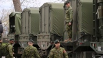 """Reservists help pack military vehicles with boats and fuel at CFB Kingston Kingston, Ont., on Tuesday, May 9, 2017. A pension fund for Canadian military reservists is once again being flagged by Canada's auditor general as being """"problematic."""" THE CANADIAN PRESS/Lars Hagberg"""
