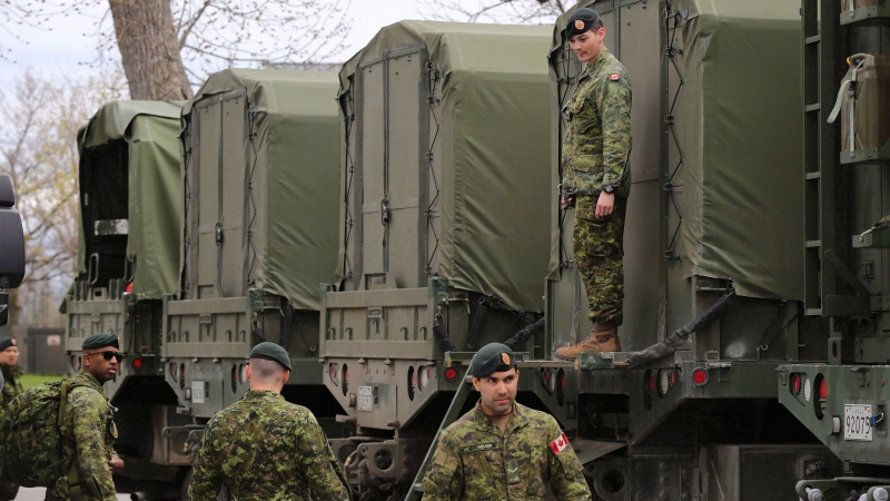 "Reservists help pack military vehicles with boats and fuel at CFB Kingston Kingston, Ont., on Tuesday, May 9, 2017. A pension fund for Canadian military reservists is once again being flagged by Canada's auditor general as being ""problematic."" THE CANADIAN PRESS/Lars Hagberg"