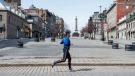 A runner passes an empty Place Jacques Cartier, Wednesday, March 25, 2020 in Montreal. Some Montreal restaurant owners are planning to take their pots and pans to the streets Wednesday morning, demanding answers on when they can reopen their restaurants. THE CANADIAN PRESS/Ryan Remiorz