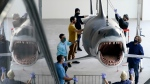 "A fiberglass replica of Bruce, the shark featured in Steven Spielberg's classic 1975 film ""Jaws,"" is raised to a suspended position for display at the new Academy of Museum of Motion Pictures, Friday, Nov. 20, 2020, in Los Angeles. (AP Photo/Chris Pizzello)"