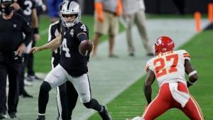 Las Vegas Raiders quarterback Derek Carr (4) runs for a gain, on Nov. 22, 2020. (Isaac Brekken / AP)