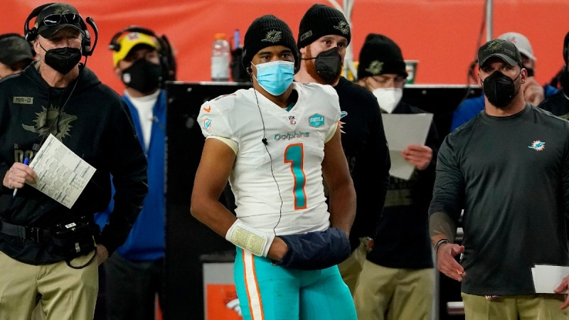 Miami Dolphins quarterback Tua Tagovailoa (1) watches from the sidelines during an NFL football game against the Denver Broncos, on Nov. 22, 2020. (Jack Dempsey / AP)