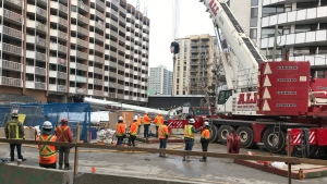 A crane is seen toppled over at Eglinton Avenue and Mount Pleasant Road. (Craig Wadman/CTV News Toronto)