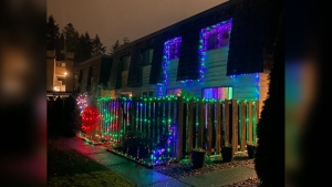 Christmas lights seen on after 11 p.m. in a North Vancouver neighbourhood. (Mathew Bond/Twitter)