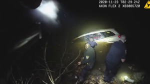 Four Ohio police officers put their lives at stake to save a woman whose car crashed into a river.
