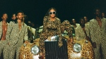 "This image released by Disney Plus shows Beyonce Knowles, center, in a scene from her visual album ""Black is King."" The pop star scored multiple Grammy nominations Tuesday, making her the leading contender with nine nominations. (Travis Matthews/Disney Plus via AP)"