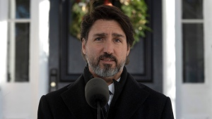 Prime Minister Justin Trudeau makes his opening remarks during a news conference outside Rideau cottage in Ottawa, Tuesday November 24, 2020. THE CANADIAN PRESS/Adrian Wyld