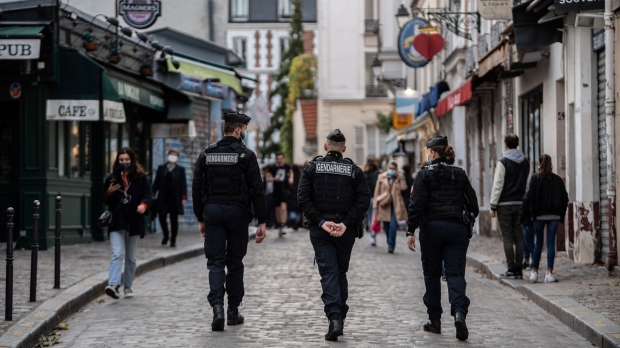 French Gendarmes patrol Paris during the country's lockdown earlier this month. (Martin Bureau/AFP/Getty Images/CNN)