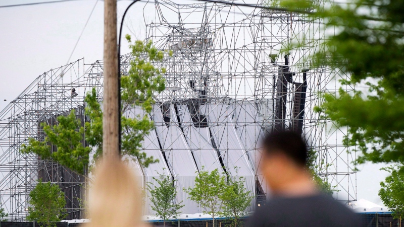 People look at a collapsed stage at Downsview Park in Toronto on Saturday, June 16, 2012. THE CANADIAN PRESS/Nathan Denette