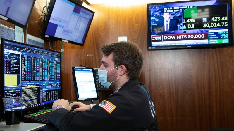 A trader at the New York Stock Exchange works at his terminal, Tuesday, Nov. 24, 2020. (Nicole Pereira/NYSE via AP)