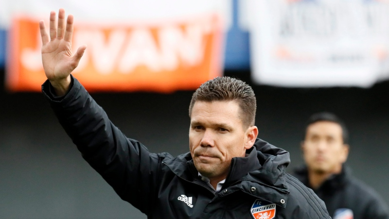 In this March 17, 2019, file photo, FC Cincinnati head coach Alan Koch acknowledges the crowd before an MLS soccer match against the Portland Timbers, in Cincinnati. (AP Photo/John Minchillo, File)