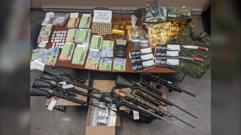 Five people are facing charges after drugs, cigarettes, and firearms were seized from a home in Bacon Ridge, Man. (Image Source: Manitoba RCMP)