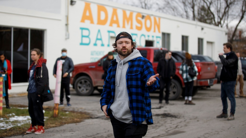 Owner of Adamson Barbecue, Adam Skelly gestures outside his restaurant in Etobicoke, Ont., Tuesday, Nov. 24, 2020. The owner of Adamson took to social media to announce he was opening for indoor dining against provincial lockdown orders. THE CANADIAN PRESS/Cole Burston