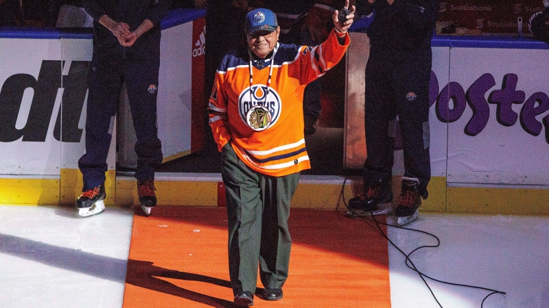 Former Chicago Blackhawks player, and the first Indigenous pro hockey player, Fred Sasakamoose is honoured at the Edmonton Oilers and Chicago Blackhawks game in Edmonton on December 29, 2017. Fred Sasakamoose, one of the first Indigenous players in the NHL, has died after battling a presumed case of COVID-19. He was 86. THE CANADIAN PRESS/Jason Franson