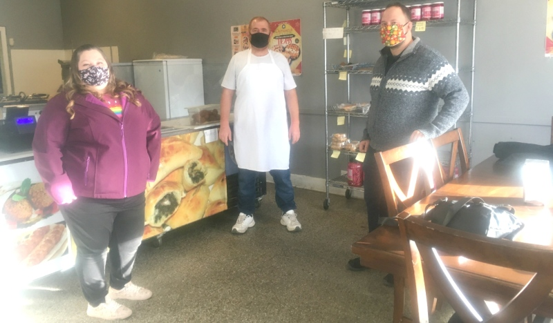 Emma Golden, left, Hussein Qarqouz,  owner of Damascus Bakery, and Philippe Paiement are seen in the bakery this week. A GoFundMe campaign is underway to help the Damascus Bakery survive after two recent crimes and the impacts of the pandemic. (Alana Everson/CTV News)
