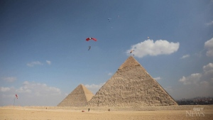 Skydivers jump over the Pyramids of Giza