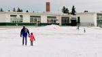 Nathan Pronyshyn walks his daughter Emmylou to school.