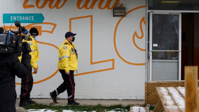 Police officers enter Adamson Barbecue in Etobicoke, Tuesday, Nov. 24, 2020. The owner of Adamson took to social media to announce he was opening for indoor dining against provincial lockdown orders. THE CANADIAN PRESS/Cole Burston