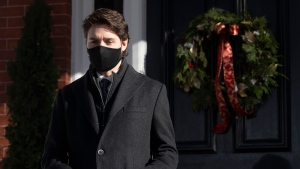 Prime Minister Justin Trudeau walk to the podium for a news conference outside of Rideau Cottage in Ottawa, Tuesday November 24, 2020. THE CANADIAN PRESS/Adrian Wyld