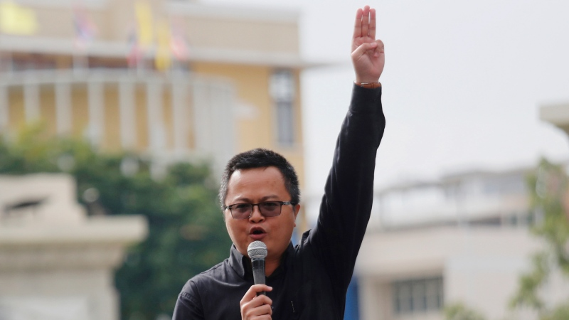 In this Oct. 14, 2020, file photo, human rights lawyer Arnon Nampha raises a three-finger salute, a symbol of resistance, talks to supporters during a protest near Democracy monument Bangkok, Thailand. (AP Photo/Sakchai Lalit, File)