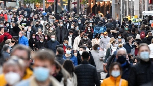 People wear the mandatory face masks in a shopping street in Dortmund, Germany, Monday, Nov. 23, 2020. (AP Photo/Martin Meissner)