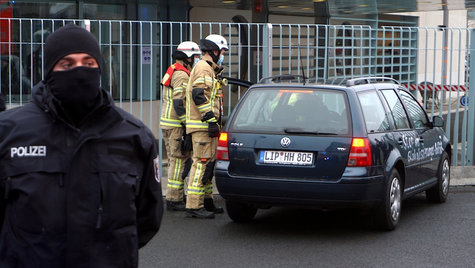 A car stand in front of the chancellery after it crashed into the front gate of the building housing German Chancellors Angela Merkel's offices in Berlin, Germany, Wednesday, Nov. 25, 2020. (AP Photo/Michael Sohn)