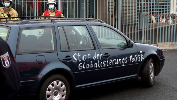 A car at the chancellery after it crashed into the front gate of the building housing German Chancellor Angela Merkel's offices in Berlin, Germany, on Nov. 25, 2020. Slogan reads 'stop the globalization policies'. (Michael Sohn / AP)