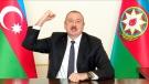 Azerbaijani President Ilham Aliyev gestures as he addresses the nation in Baku, Azerbaijan, on Nov. 25, 2020. (Azerbaijani Presidential Press Office via AP)