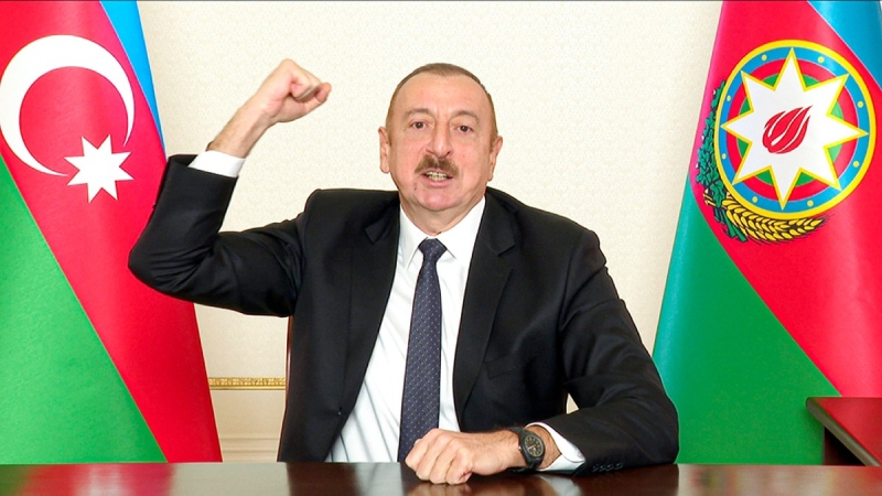 Azerbaijani President Ilham Aliyev gestures as he addresses the nation in Baku, Azerbaijan, on Nov. 25, 2020. (Azerbaijani Presidential Press Office via AP)