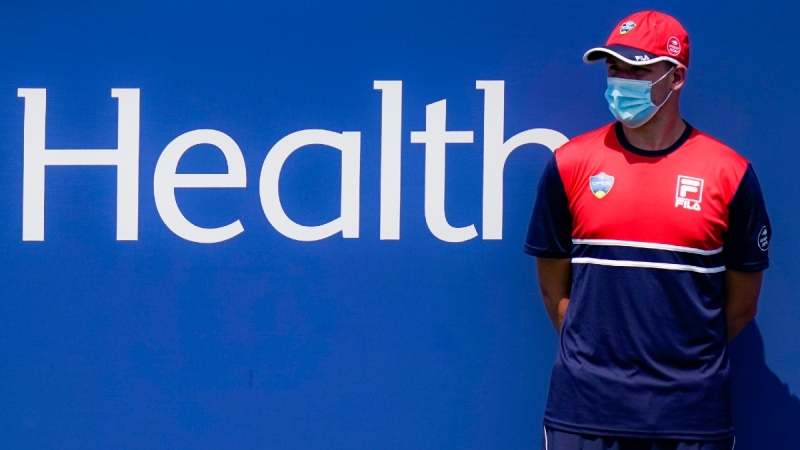 A ball boy stands at attention while wearing a protective mask during the Western & Southern Open tennis tournament at Flushing Meadows in New York, on  Aug. 22, 2020. (Frank Franklin II / AP)