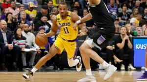 Los Angeles Lakers guard Avery Bradley, left, drives against Sacramento Kings forward Nemanja Bjelica in Sacramento, Calif., on Feb. 1, 2020. (Rich Pedroncelli / AP)