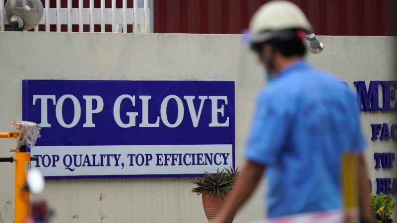 Workers from Top Glove walk outside Top Glove factory in Shah Alam, Malaysia, on Nov. 25, 2020. (Vincent Thian / AP)