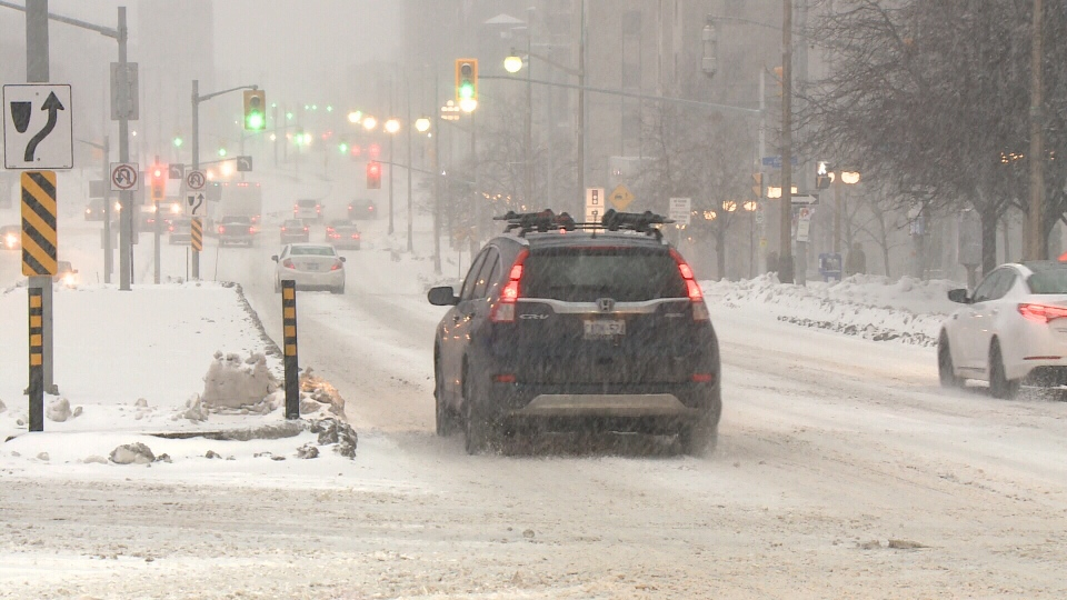A driver navigates a greasy Ottawa road during a snowfall Wed., Nov. 25, 2020. (Jim O'Grady / CTV News Ottawa)