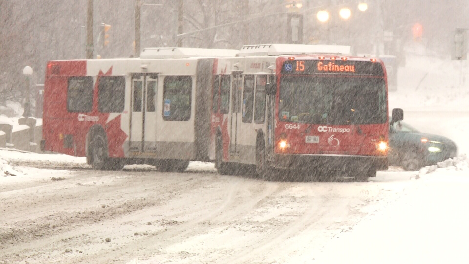 An OC Transpo bus is seen driving on a snowy road Wed., Nov. 25, 2020. (Jim O'Grady / CTV News Ottawa)
